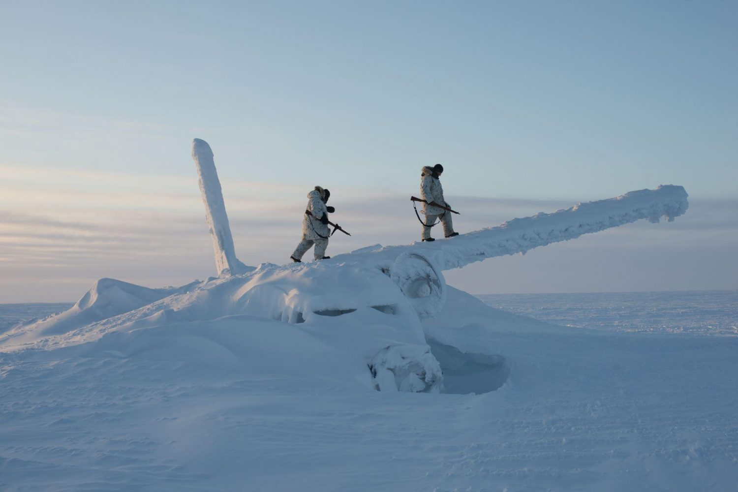 Canadian soldiers walking on the wreckage of an airplane, -50 Celsius, Resolute Bay, Nunavut, Canada